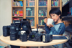 Young Asian boy taking a break during photographic work Stock Photos