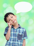 Young Asian boy thinking Royalty Free Stock Photos