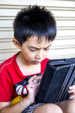 Young asian boy use to tablet. Stock Photo