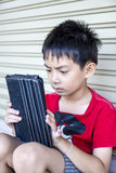 Young asian boy use to tablet. Stock Images
