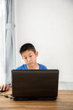 Young Asian boy using laptop technology at home. copyspace Stock Photo