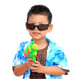 Young Asian boy with water gun on white background.child playing. Fun with the water gun in Songkran holiday Stock Images