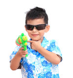 Young Asian boy with water gun on white background.child playing. Fun with the water gun in Songkran holiday Royalty Free Stock Photography