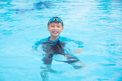 Boy wearing blue goggles and smiling in pool Royalty Free Stock Photography