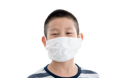 Young Asian boy wearing mask Royalty Free Stock Image