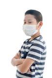 Young Asian boy wearing mask Stock Photos