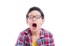 Boy yawning over white background royalty free stock photos