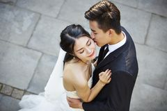 Young asian bride and groom dancing in open air Royalty Free Stock Images