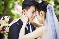Asian bride and groom at wedding Royalty Free Stock Photos