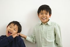 Young Asian brothers stock images