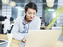 Young asian business executive working in office Royalty Free Stock Images