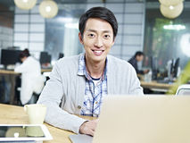 Young asian business executive working in office Royalty Free Stock Photography