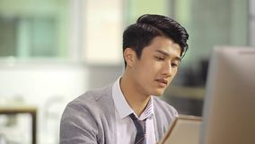 Young asian business executive working in office stock footage