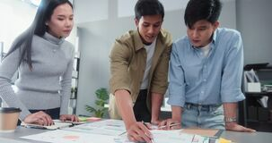 Asian business financial team work together in project brainstorm meeting. Cooperate teamwork, strategy planning