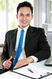 Young asian business man at the office Stock Photos