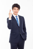Young Asian business man showing lucky sign. Isolated on white background Royalty Free Stock Photo