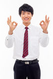Young Asian business man showing okay sign. Royalty Free Stock Image