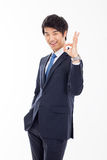 Young Asian business man showing okay sign. Royalty Free Stock Photo