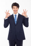 Young Asian business man showing okay sign. Royalty Free Stock Photography