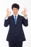 Young Asian business man showing okay sign. Stock Photography