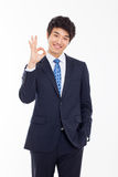 Young Asian business man showing okay sign. Stock Photos