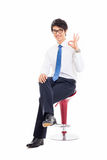 Young Asian business man showing okay sign. Stock Images