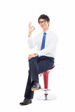 Young Asian business man showing okay sign. Stock Image