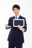 Young Asian business man showing a pad PC Royalty Free Stock Images