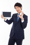 Young Asian business man showing a pad PC Royalty Free Stock Photos