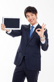 Young Asian business man showing a pad PC Royalty Free Stock Photo