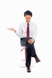 Young Asian business man showing something Royalty Free Stock Photo