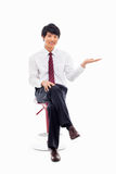 Young Asian business man showing something Royalty Free Stock Photography
