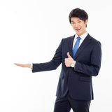 Young Asian business man showing something Royalty Free Stock Image