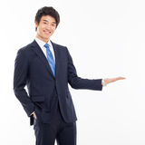 Young Asian business man showing something Stock Images