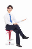 Young Asian business man showing something Stock Image