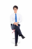 Young Asian business man sitting on the chair. Stock Photo