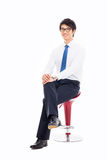 Young Asian business man sitting on the chair. Royalty Free Stock Photography