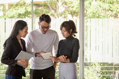 Young asian business people ,man and woman, working with team in office Royalty Free Stock Image