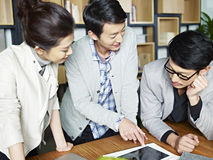 Young asian business people working together in office Royalty Free Stock Photo