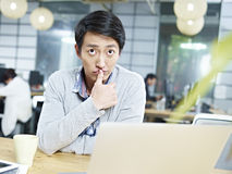 Young asian business person thinking hard in office Royalty Free Stock Photo