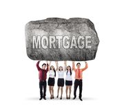 Asian business team lifting mortgage word stock photography
