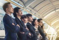 The young Asian business team stands with confidence and pride. stock image