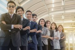 The young Asian business team stands with confidence and pride. royalty free stock images