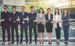 The young Asian business team stands with confidence and pride. stock photos
