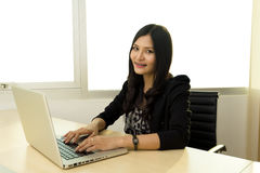 Young asian Business woman. Portrait of successful Asian business woman at desk with laptop Mostly  in office Royalty Free Stock Images
