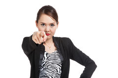 Young Asian business woman angry and point to camera Stock Photos
