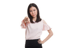 Young Asian business woman angry and point to camera. Royalty Free Stock Image