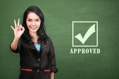 Young asian business woman with approval sign. Business concept Royalty Free Stock Photos