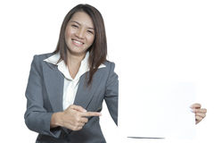 Young Asian business woman attractive brunetee showing blank sig. Happy smiling young pretty attractive brunette Asian business woman standing positive showing Royalty Free Stock Photography