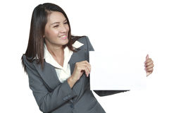 Young Asian business woman attractive brunetee showing blank sig. Happy smiling young pretty attractive brunette Asian business woman standing positive showing Stock Photo